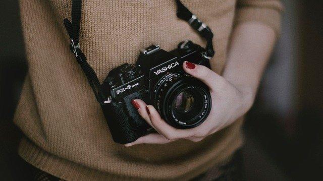 člověk s fotoaparátem